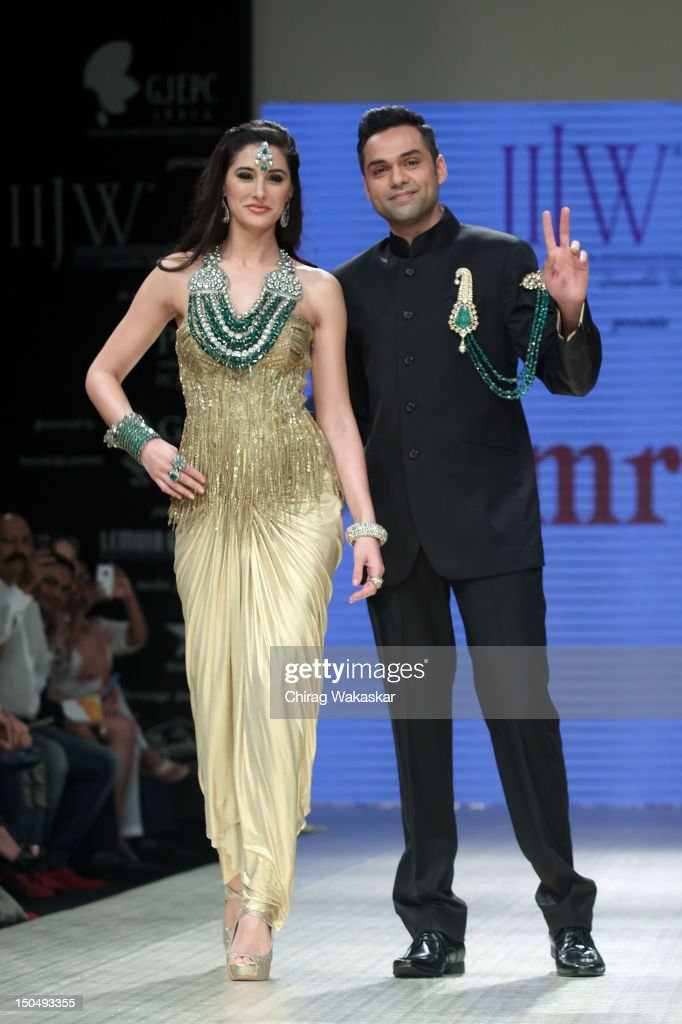 <a gi-track='captionPersonalityLinkClicked' href=/galleries/search?phrase=Abhay+Deol&family=editorial&specificpeople=5377911 ng-click='$event.stopPropagation()'>Abhay Deol</a> (R) walks the runway with Nargis Fakhri (L) in a Amrapali Jewellery design at the India International Jewellery Week 2012 Day 1 at the Grand Hyatt on on August 19, 2012 in Mumbai, India.