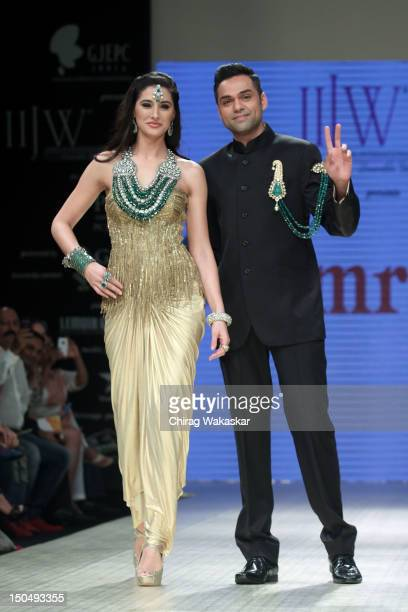 Abhay Deol walks the runway with Nargis Fakhri in a Amrapali Jewellery design at the India International Jewellery Week 2012 Day 1 at the Grand Hyatt...
