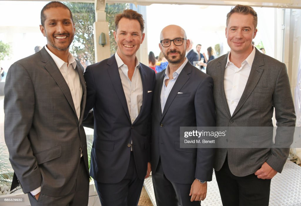 Abhijay Prakash, Focus Features COO, Jason Cassidy, President of Marketing for Focus Features, Peter Kujawski, Chairman of Focus Features, and Robert Walak, President of Focus Features, attend Focus Features' 15th Anniversary party at the Cannes Film Festival at Baoli Beach on May 19, 2017 in Cannes, France.
