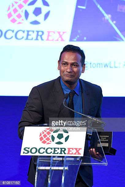 Abhijeet Barse from organisation Slum Soccer speaks after receieving the FIFA Diversity Award during the Soccerex Global Convention at Manchester...
