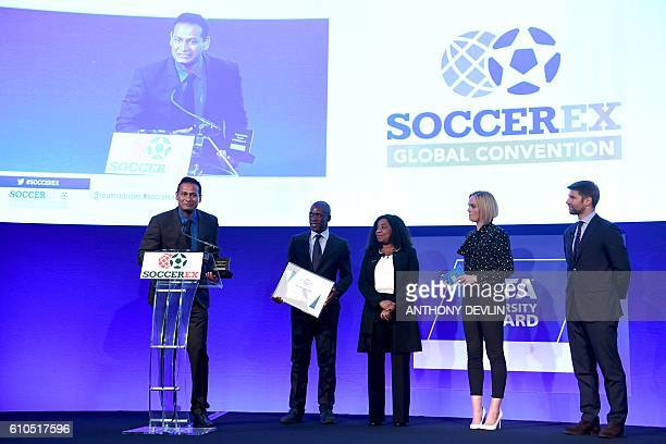 Abhijeet Barse from organisation Slum Soccer speaks after receieving the FIFA Diversity Award as Dutch former international footballer Clarence...