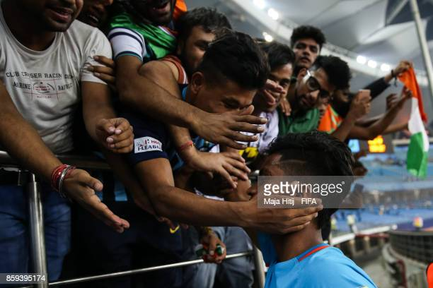 Abhijit Sarkar of India with the fans after the FIFA U17 World Cup India 2017 group A match between India and Colombia at Jawaharlal Nehru Stadium on...