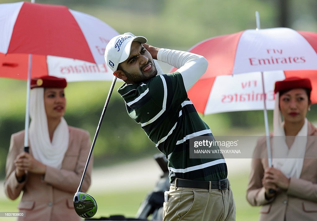 Abhijit Singh Chadha of India tees off on the eighteenth hole during the Avantha Masters golf tournament in Greater Noida, on the outskirts of New Delhi, on March 15, 2013. AFP PHOTO/ MANAN VATSYAYANA