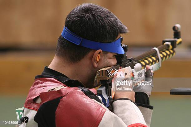 Abhinav Bindra aims at the target during 10m air rifle event of Commonwealth Games at the Dr Karni Singh Shooting Range in New Delhi on Wednesday...