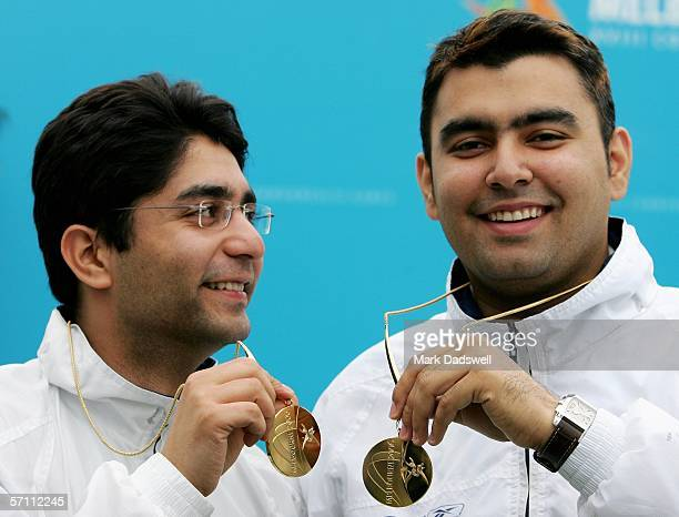Abhinav Bindra and Gagan Narang of India display their gold medals for winning the Men's 10m Air Rifle Pairs Final at the Melbourne International...