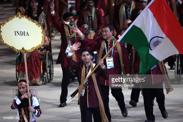 Abhinav Bindra leads out the 619member Indian squad during the Opening Ceremony for the Delhi 2010 Commonwealth Games at Jawaharlal Nehru Stadium on...