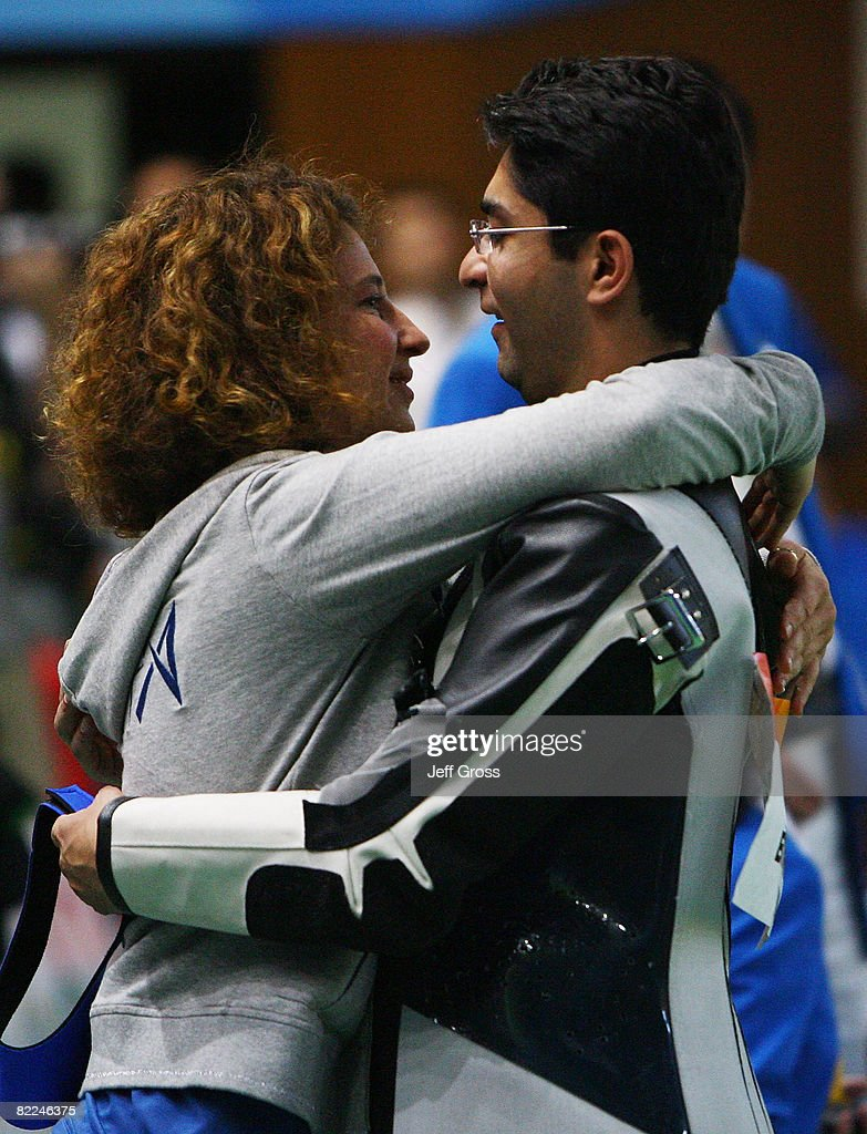 Abhinav Bindra of India is congratulated by his coach Gabriele Buhlmann after winning the gold medal in the Men's 10m Air Rifle Final at the Beijing...