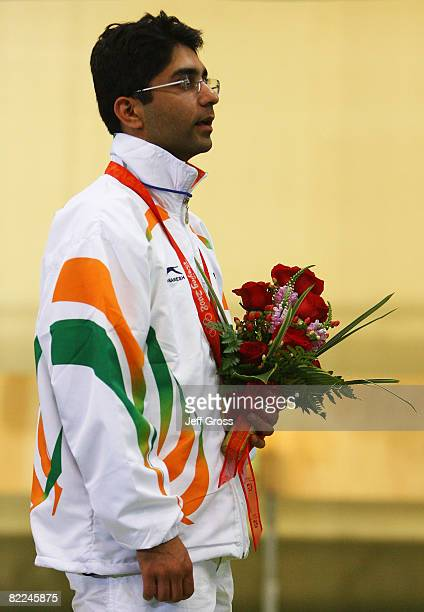 Abhinav Bindra of India sings the national anthem with his gold medal in the Men's 10m Air Rifle Final at the Beijing Shooting Range Hall on day 3 of...