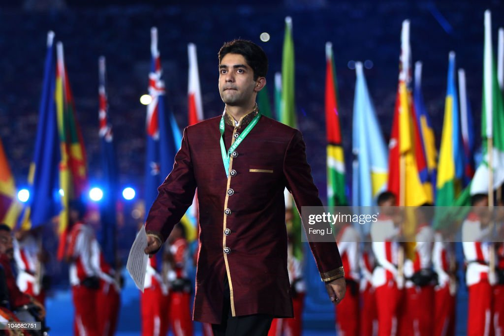 Abhinav Bindra of India walks towards the centre stage to deliver an oath on behalf of all the athletes during the Opening Ceremony for the Delhi...