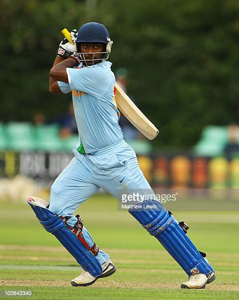 Abhinav Mukund of India hits the ball away towards the boundary during the One Day International match between England Lions and India A at New Road...