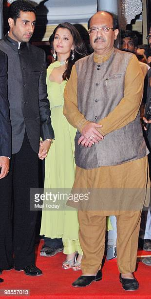 Abhishek and Aishwarya Rai Bachchan with Amar Singh at the wedding reception of Laila Khan and Farhan Furniturewala in Mumbai on April 16 2010