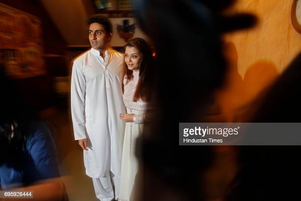 Abhishek Bachchan and Aishwarya Rai Bachchan pose for the photograph after returned home from Seven hill hosptel on Tuesday evening at Janki