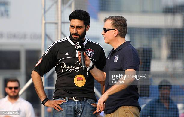 Abhishek Bachchan Bollywood actor speaks to John Dykes comparer during the half time of an exhibition match played between BPL legends and All star...