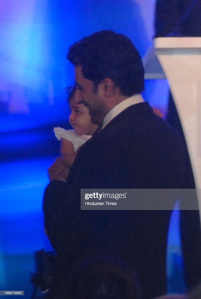 Abhishek Bachchan takes his daughter Aradhya outside the hall after she started crying during a function to confer Aishwarya Rai Bachchan with French Knight of the Order of Arts and Letters for her contribution to the arts on November 1, 2012 in Mumbai, India. She also celebrated also celebrated her 39th birthday.