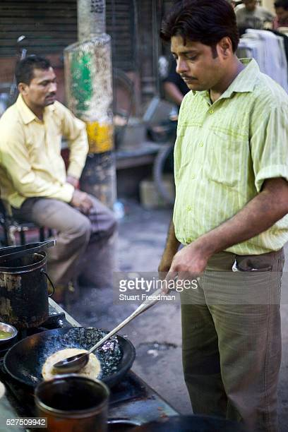 Abhishek Dikshit one of the owners of the famous Parawthe Wala restaurant in Old Delhi India cooks a Paratha The parantha is an Indian fried bread...