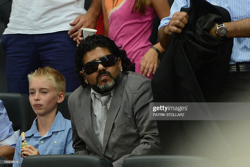 Abi Atici, a Maradona lookalike sits in the tribune prior to the friendly football match Germany vs Argentina on August 15, 2012 in Frankfurt am Main, western Germany. STOLLARZ