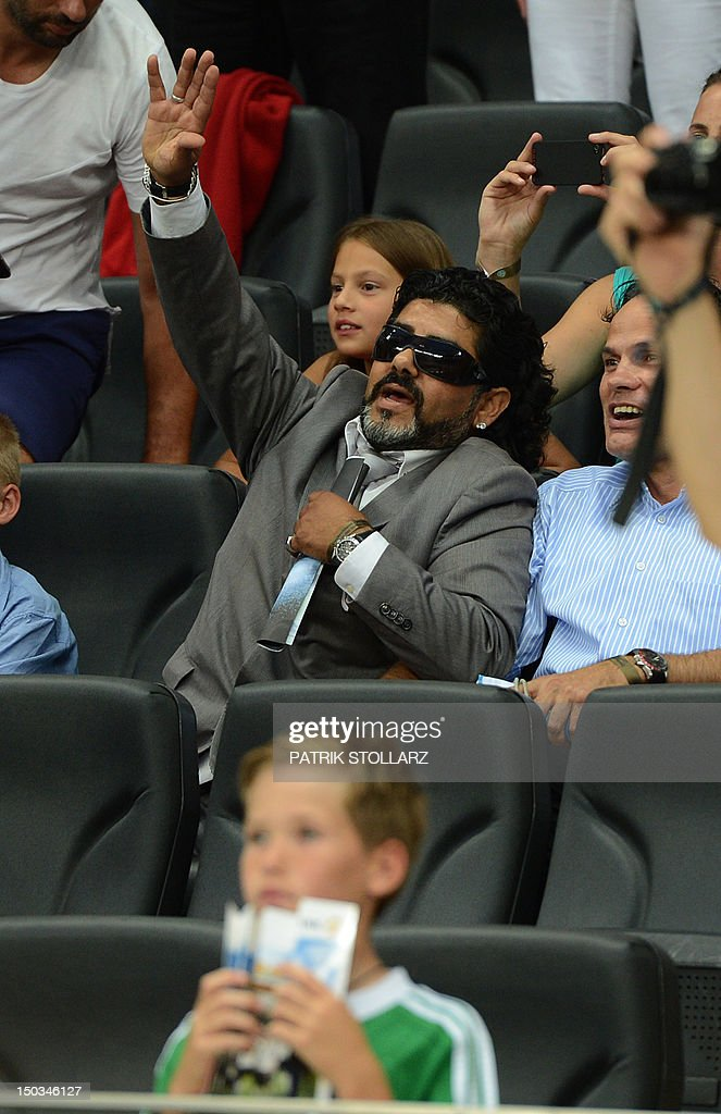 Abi Atici, a Maradona lookalike sits in the tribune prior to the friendly football match Germany vs Argentina on August 15, 2012 in Frankfurt am Main, western Germany.