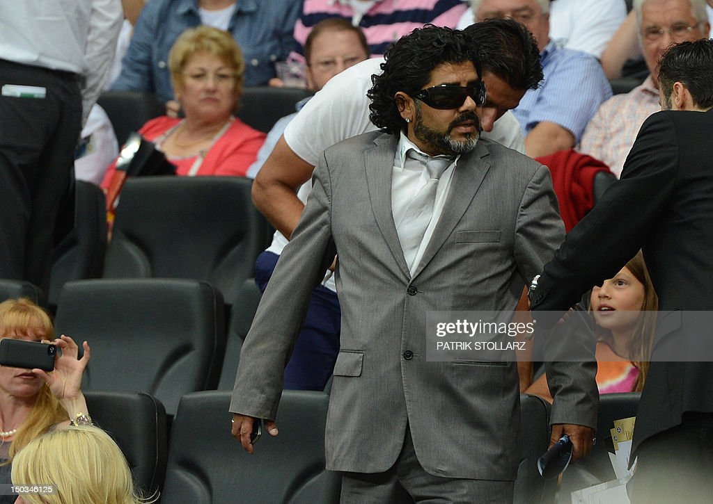 Abi Atici, a Maradona lookalike stands in the VIP tribune prior to the friendly football match Germany vs Argentina on August 15, 2012 in Frankfurt am Main, western Germany.