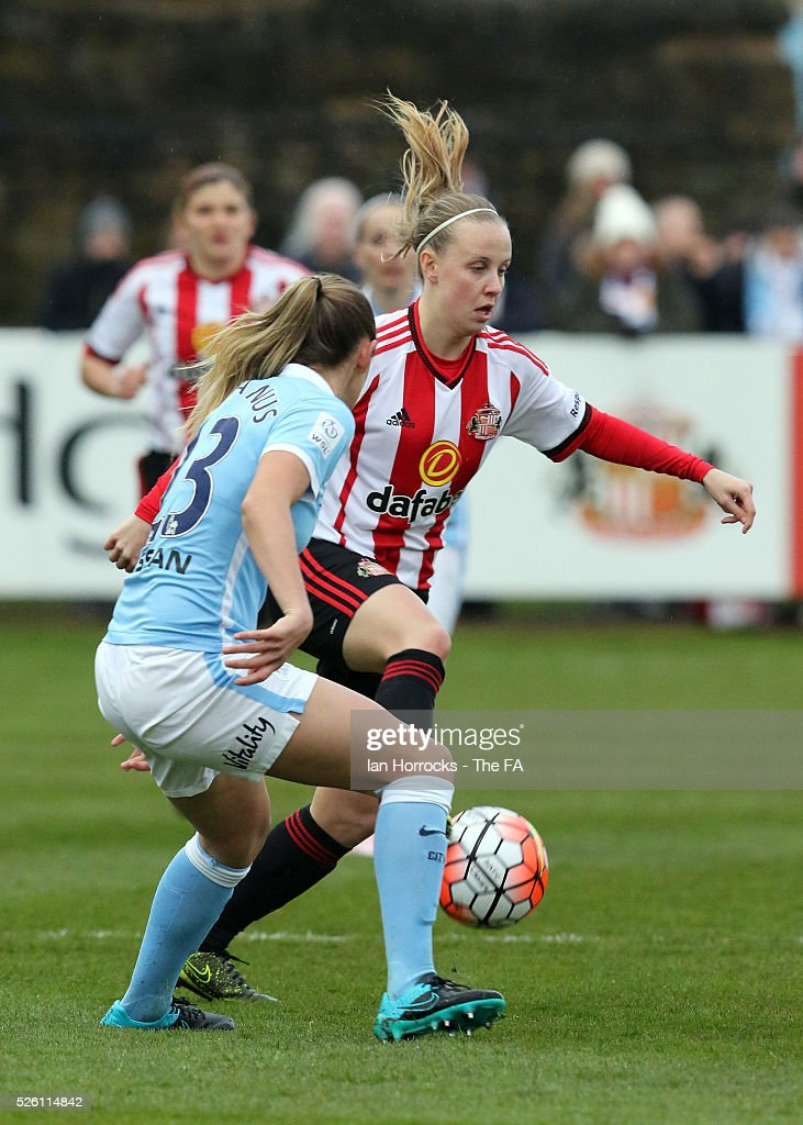 Abi McManus of Manchester City (L) chases down Beth Mead of Sunderland during the WSL 1 match between Sunderland AFC Ladies and Manchester City Women at The Hetton Center on April 29, 2016 in Hetton, England.