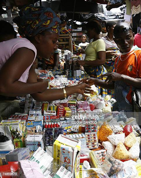 Shoppers buy smuggled counterfeit medicine 14 June 2007 on the Adjame market in Abidjan Ivorian pharmacists are worried about the multiplication of...