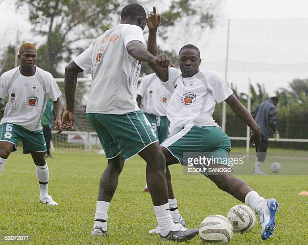 Star striker from the Ivory Coast national team 'the Elephants' Aruna Dindane trains 15 June 2005 in Abidjan four days ahead of the Ivory Coast...