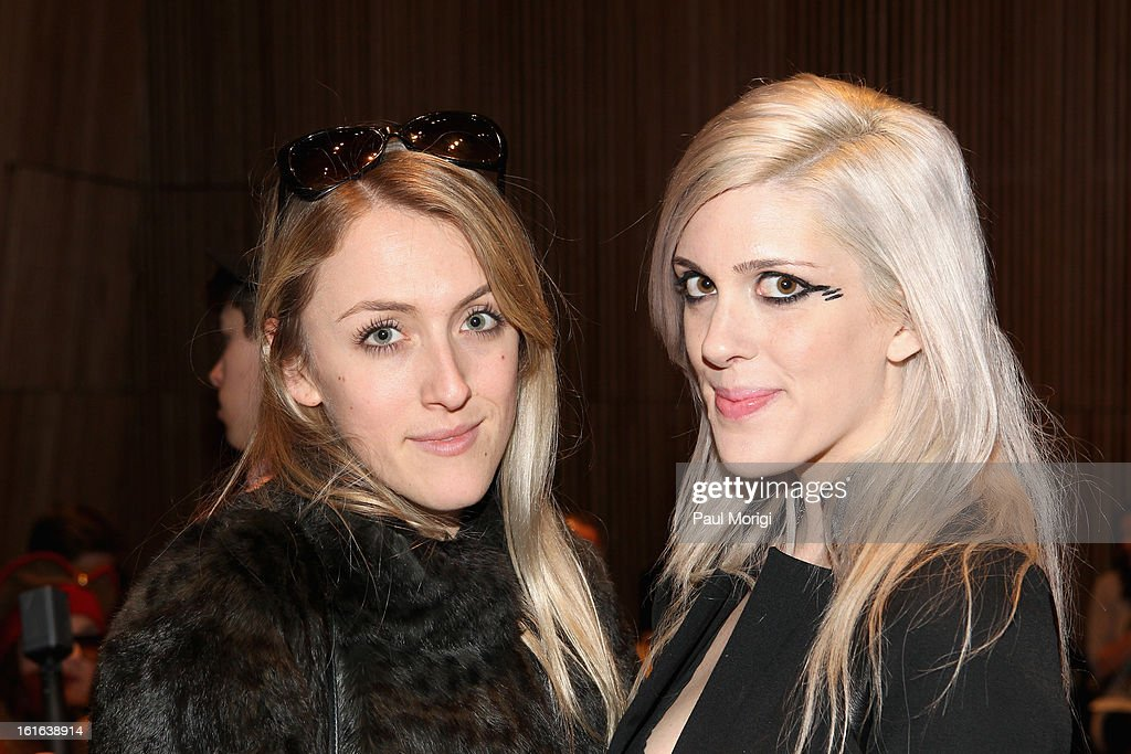 Abigail Breslin and Emily Bache attend the Douglas Hannant Fall 2013 Collection during Mercedes-Benz Fashion Week at Dimenna Center for Classical Music on February 13, 2013 in New York City.