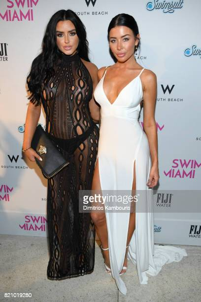 Abigail Ratchford and guest attend the SWIMMIAMI Sports Illustrated Swimsuit 2018 Collection at WET Deck at W South Beach on July 22 2017 in Miami...