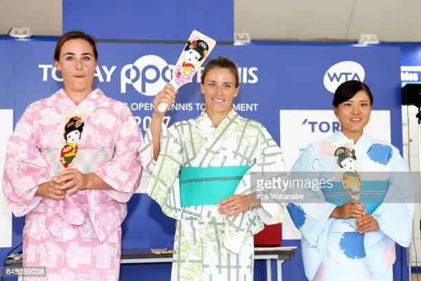 Abigail Spears and Alicja Rosolska and Makoto Ninomiya wearing Yukata plays Hagoita traditional wooden paddle game during day two of the Toray Pan...