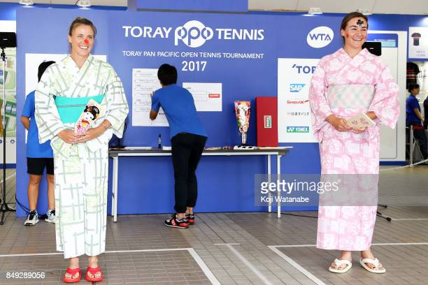 Abigail Spears and Alicja Rosolska wearing Yukata plays Hagoita traditional wooden paddle game during day two of the Toray Pan Pacific Open Tennis At...