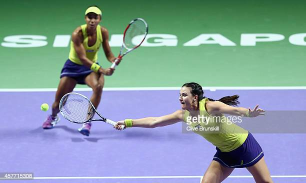 Abigail Spears and Raquel KopsJones of the United States in action against Cara Black of Zimbabwe and Sania Mirza of India in their doubles quarter...