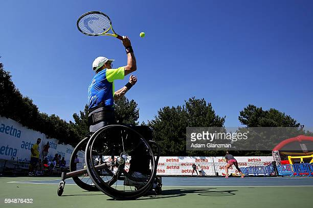 Abigail Spears and Raquel KopsJones participate in a wheelchair tennis clinic on day 4 of the Connecticut Open at the Connecticut Tennis Center at...