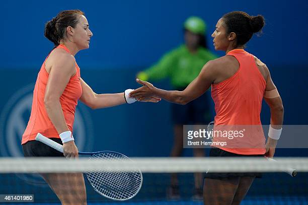 Abigail Spears celebrates with playing partner Raquel KopsJones of the USA after winning a point in their first round doubles match against Dominika...