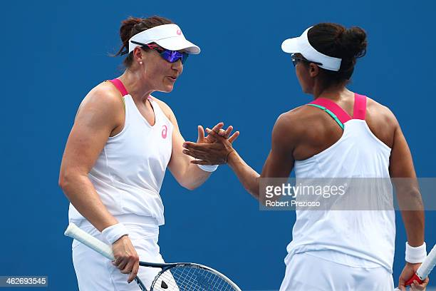 Abigail Spears of the United States and Raquel KopsJones of the United States talk tactics in their first round doubles match against ChiaJung Chuang...