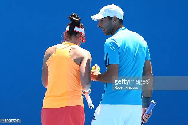 Abigail Spears of the United States and Santiago Gonzalez of Mexico in action in their first round mixed doubles match Arina Rodionova of Australia...