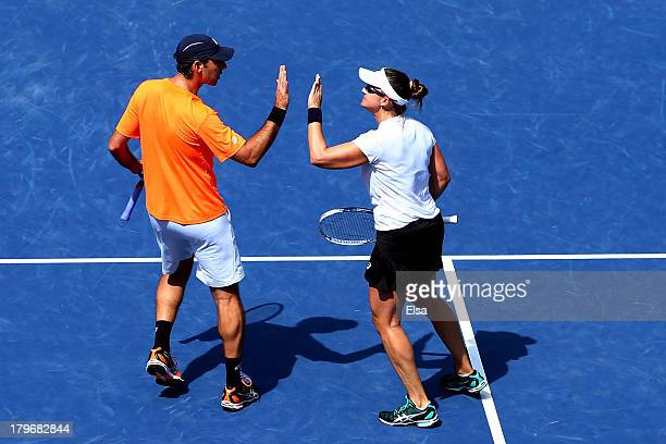 Abigail Spears of the United States of America and Santiago Gonzalez of Mexico tap hands during their mixed doubles final match against Max Mirnyi of...