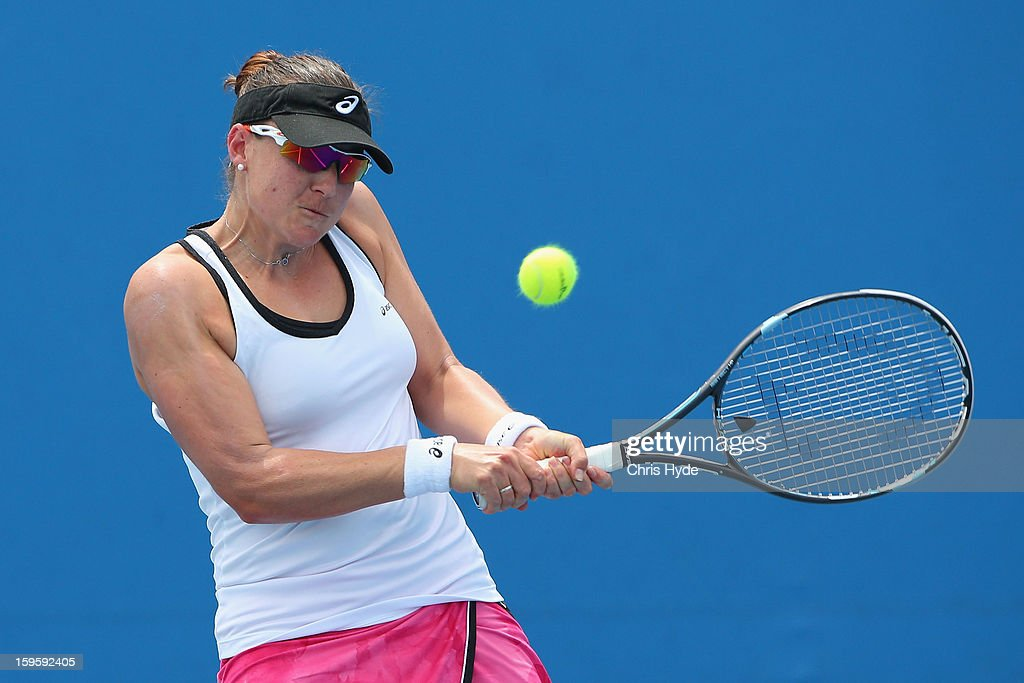 Abigail Spears of the United States of America plays a backhand in her first round doubles match with Raquel Kops-Jones of the United States of America against Kirsten Flipkens of Belgium and Magdalena Rybarikova Slovakia during day four of the 2013 Australian Open at Melbourne Park on January 17, 2013 in Melbourne, Australia.