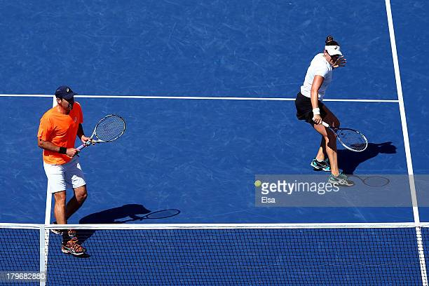 Abigail Spears of the United States of America plays a backhand next to Santiago Gonzalez of Mexico tap hands during their mixed doubles final match...