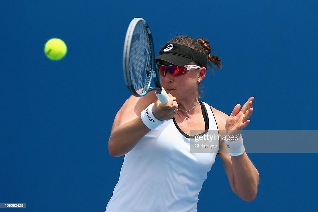 Abigail Spears of the United States of America plays a forehand in her first round doubles match with Raquel Kops-Jones of the United States of America against Kirsten Flipkens of Belgium and Magdalena Rybarikova Slovakia during day four of the 2013 Australian Open at Melbourne Park on January 17, 2013 in Melbourne, Australia.