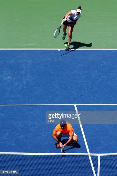 Abigail Spears of the United States of America serves behind Santiago Gonzalez of Mexico tap hands during their mixed doubles final match against Max...