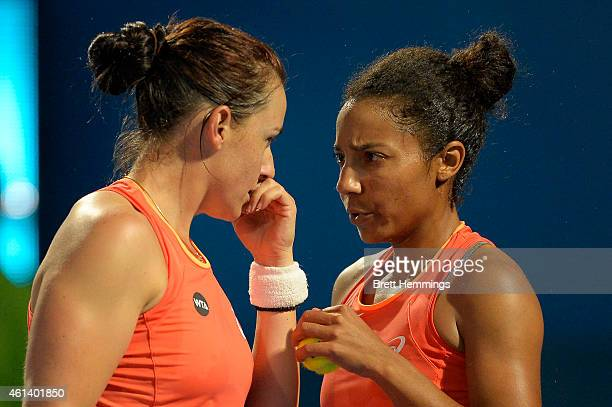 Abigail Spears speaks with playing partner Raquel KopsJones of the USA during their first round doubles match against Dominika Cibulkova of Slovakia...