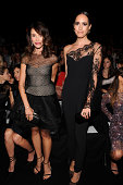 Abigail Spencer and Louise Roe attend the Monique Lhuillier fashion show during MercedesBenz Fashion Week Spring 2015 at The Theatre at Lincoln...