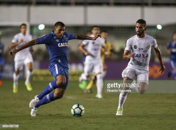 Abila of Cruzeiro battles for the ball with Thiago Maia of Santos during the match between Santos and Cruzeiro as a part of Campeonato Brasileiro...
