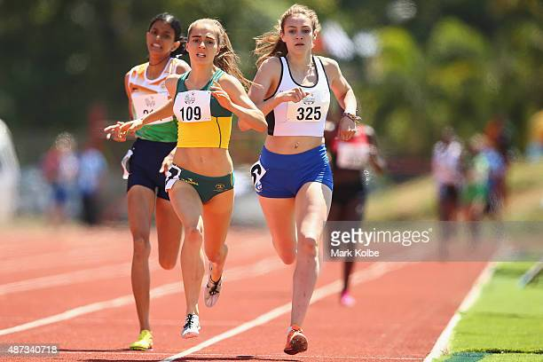Abitha Mary Manuel of India Amy HardingDelooze of Australia and Carys MCAulay of Scotland race in the girls 800m final during the athletics...