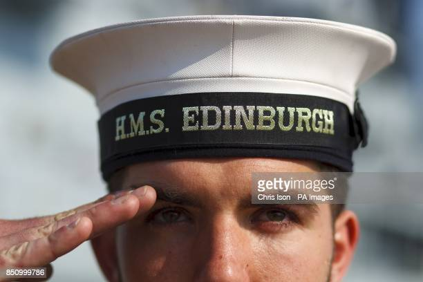 Able Seaman Tom Bradshaw from York salutes in front of HMS Edinburgh the last of the Royal Navy's Type 42 Destroyers which was decommissioned at...