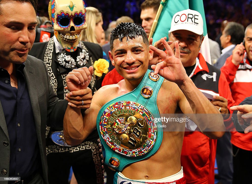 Abner Mares celebrates after defeating Daniel Ponce de Leon as referee Jay Nady ends the fight in the ninth round in their WBC featherweight title...