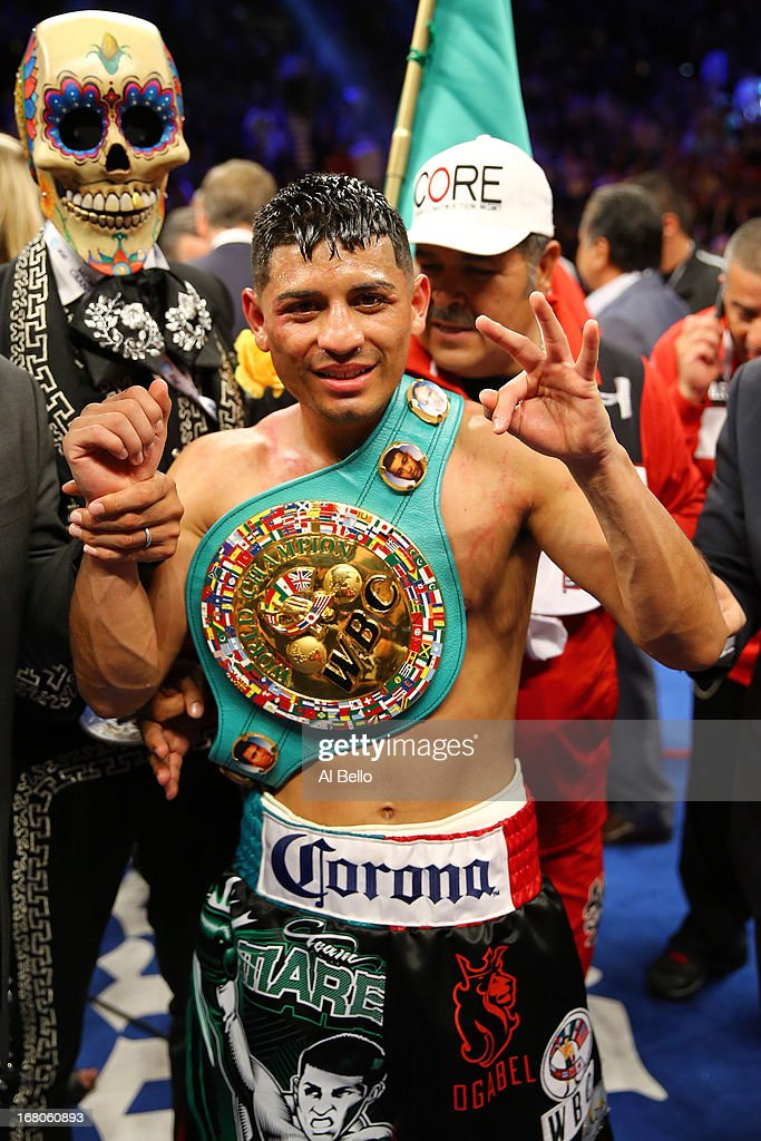 Abner Mares celebrates after defeating Daniel Ponce de Leon as referee Jay Nady ends the fight in the ninth round in their WBC featherweight title bout at the MGM Grand Garden Arena on May 4, 2013 in Las Vegas, Nevada.