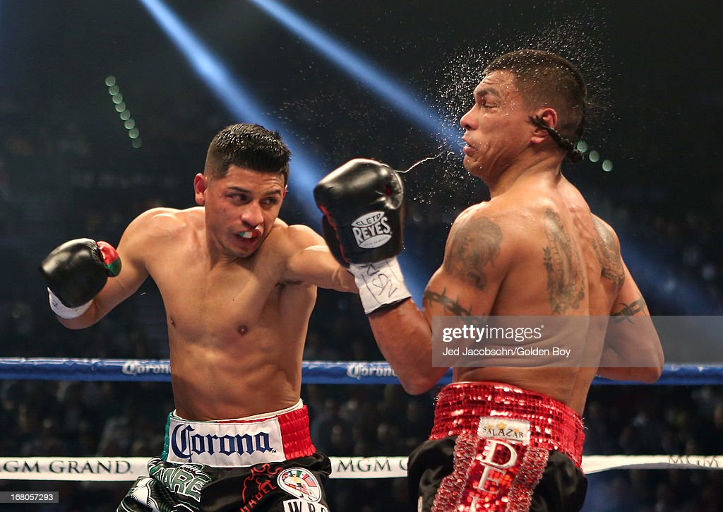 Abner Mares connects with a left to the face of Daniel Ponce de Leon in their WBC featherweight title bout at the MGM Grand Garden Arena on May 4, 2013 in Las Vegas, Nevada.