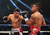 Abner Mares connects with a left to the face of Daniel Ponce de Leon in their WBC featherweight title bout at the MGM Grand Garden Arena on May 4...