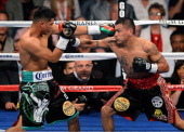 Abner Mares connects with a left to the face of Daniel Ponce de Leon in the third round of their WBC featherweight title bout at the MGM Grand Garden...