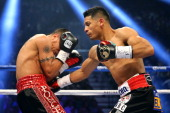 Abner Mares connects with a right to the body of Daniel Ponce de Leon in their WBC featherweight title bout at the MGM Grand Garden Arena on May 4...